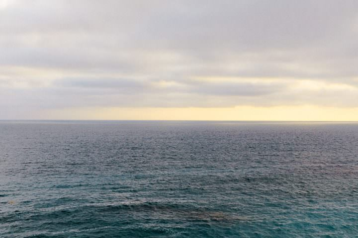 Photo of the Pacific ocean taken at sunset off the coast of Laguna Beach