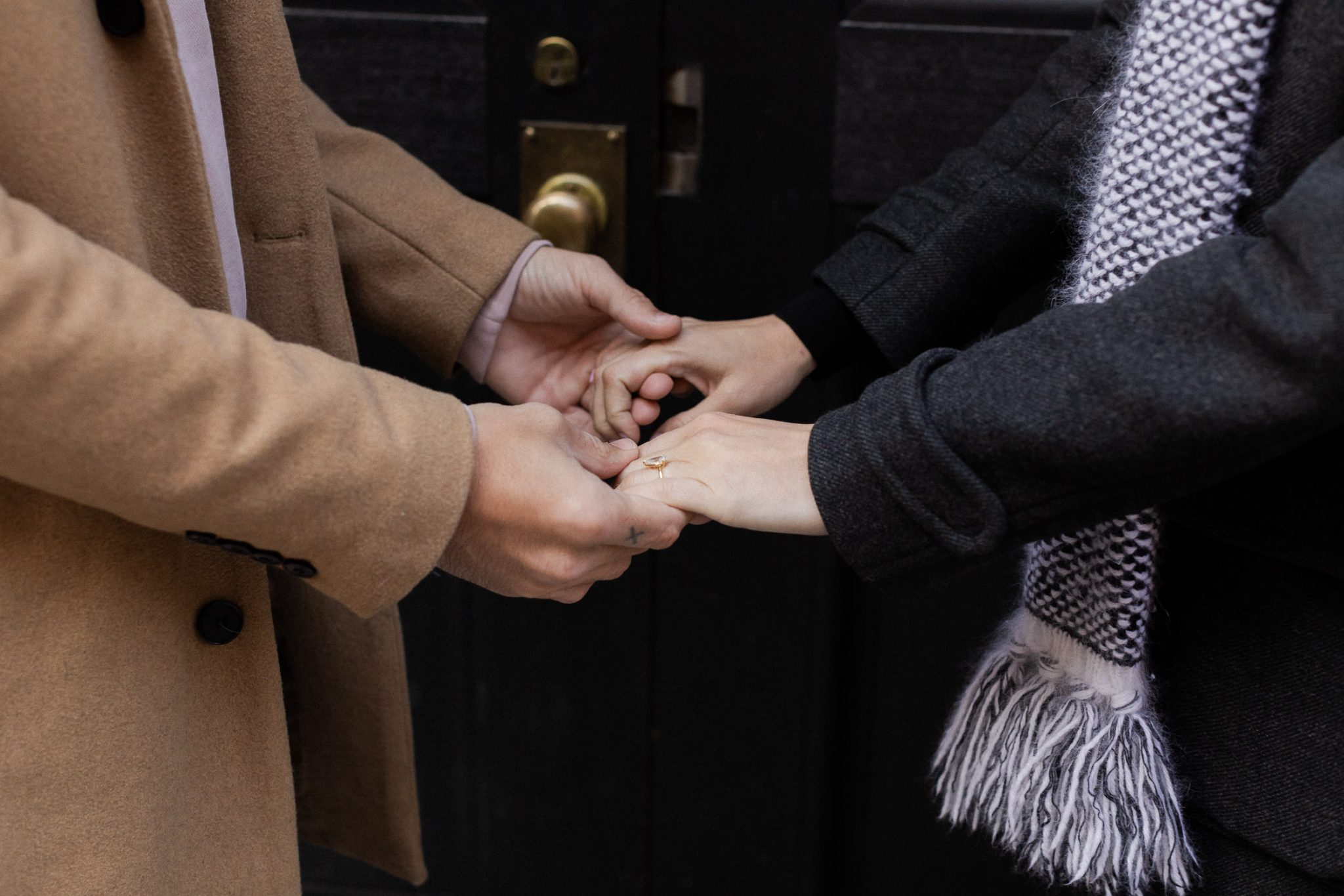 Hands joined together celebrating their future together